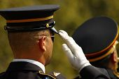 image of arlington cemetery  - A soldier salutes during a ceremony at the Arlington National Ceremony - JPG