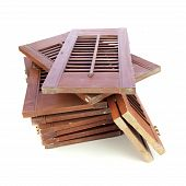 stock photo of louvers  - Used window shutters recycled building materials on white - JPG