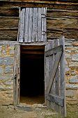 Open door to a log building