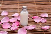 rose Petals and massage oil on mat
