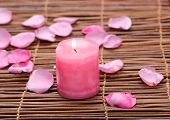 rose Petals and candle on mat