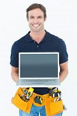 Portrait of happy architect holding laptop over white background