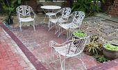 White Iron Chair In The Garden