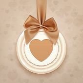 Badge with heart, golden ribbon and a bow