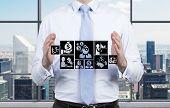 Businessman Holding Symbol