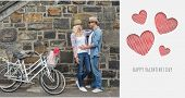 Hip young couple hugging by brick wall with their bikes against cute valentines message