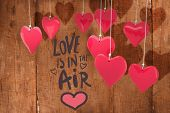 love is in the air against wooden planks
