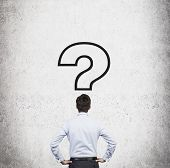 Businessman And  Question Marks