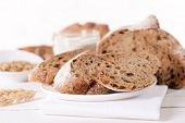 Tasty bread on table on light background