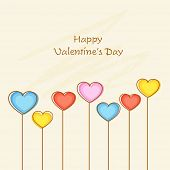 Happy Valentine's Day celebration greeting card decorated by colorful heart shape flowers.