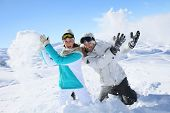 picture of snowball-fight  - Couple in snowy mountain doing snowballs fight - JPG