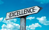 Excellence sign with sky background