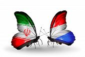 Two Butterflies With Flags On Wings As Symbol Of Relations Iran And Luxembourg