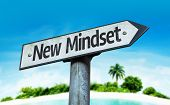 New Mindset sign with a beach on background