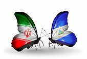 Two Butterflies With Flags On Wings As Symbol Of Relations Iran And Nicaragua