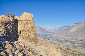 stock photo of karakoram  - Scenic ancient ruins on the ridge in Pamir mountains in Tajikistan - JPG