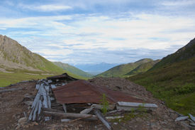 image of hatcher  - Roof covering collapsed building on mine tailings at Independence Mine - JPG