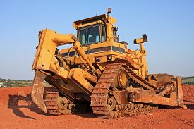 stock photo of bulldozers  - bulldozer working on a road construction site - JPG