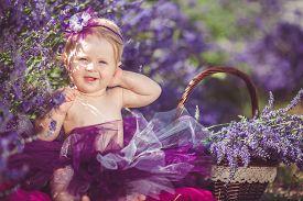 stock photo of bow tie hair  - Cute little girl with blond hair - JPG