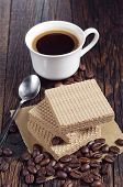 picture of condensation  - Wafers with caramelized condensed milk and cup of hot coffee on rustic wooden table - JPG