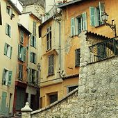 foto of nice house  - Multicolored houses with green shutters in the old town of Nice - JPG