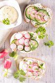 stock photo of canapes  - bread with radish - JPG