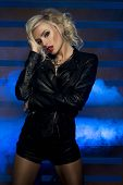 stock photo of voluptuous lips  - Sexy beautiful blonde woman posing in lack leather clothes - JPG