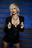 pic of voluptuous lips  - Sexy beautiful blonde woman posing in lack leather clothes - JPG