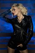 foto of voluptuous lips  - Sexy beautiful blonde woman posing in lack leather clothes - JPG