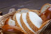 picture of fresh slice bread  - Handmade fresh sliced bread in a wicker basket - JPG
