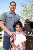 image of mailbox  - Hispanic Father And Son Checking Mailbox - JPG