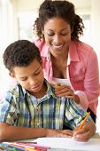 picture of homework  - Mother Helping Son With Homework At Home - JPG
