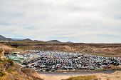 foto of scrap-iron  - Scrap Yard With Pile Of Crushed Cars in tenerife canary islands spain - JPG