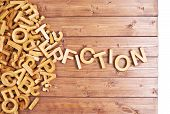 image of fiction  - Word fiction made with block wooden letters next to a pile of other letters over the wooden board surface composition - JPG