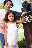 foto of granddaughter  - Hispanic Grandmother And Granddaughter Checking Mailbox - JPG