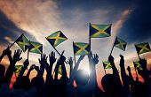 image of jamaican flag  - Group of People Waving Flag of Jamaica in Back Lit Concept - JPG