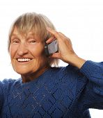 image of old lady  - Smiling old lady communicating through mobile phone and thumb up - JPG