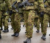 picture of soldier  - Lined up squad of Estonian soldiers in a military uniform outdoors - JPG