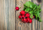 foto of radish  - Fresh organic radish on a old wooden background - JPG