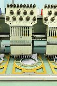 stock photo of machine  - Machine embroidery is an embroidery process whereby a sewing machine - JPG
