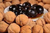 stock photo of walnut  - Jam from walnuts and walnuts close up - JPG