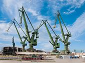 stock photo of shipyard  - Cranes in the shipyard in Gdansk Poland where the Solidarity movement began in 1980 - JPG