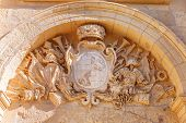 pic of crossed swords  - Coat of arms over arch entry in ancient part of Mdina old capital of Malta - JPG