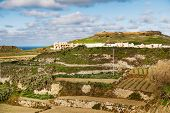 picture of gozo  - View on fields and lighthouse on the top of mountain - JPG
