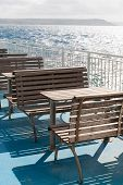 stock photo of gozo  - Wooden tables and benches on top deck of ferry - JPG