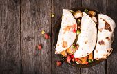 stock photo of sandwich wrap  - Chicken wrap sandwiches in the plate on wooden backgroundselective focus and blank space - JPG