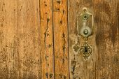 stock photo of keyholes  - Closeup take of the wooden planks of and old door and its keyhole - JPG