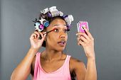 foto of african american hair styles  - An African American woman putting on makeup - JPG