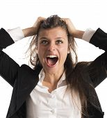 foto of scream  - Furious businesswoman stressed out from work screams - JPG