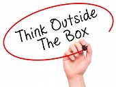 image of thinking outside box  - Man Hand writing Think Outside The Box with marker on transparent wipe board - JPG